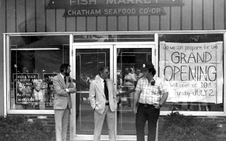 The Chatham Seafood Cooperative Fish Market after moving. Service Co-op Manager Bill Hamilton, Chairman of Selectmen Thorne W. Campbell Jr. talk with a patron on opening day. 1981. FILE PHOTO  (photo: )