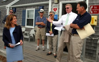 At Saquatucket Harbor in Harwich Port, the lieutenant governor (left) spoke with (from left) Selectman Larry Ballantine, State Rep. Sarah Peake, Town Administrator Christopher Clark and Harbormaster John Rendon.  ALAN POLLOCK PHOTO  (photo: Alan Pollock)