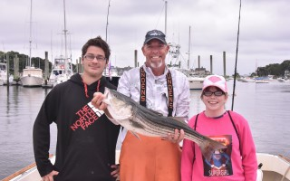 Hedeman Hercules and Sarah Taylor celebrate their big catch with charter captain John Doherty, who took them fishing as part of the Little 3 aspect of the Big 3 Fishing Tournament on July 14. Kat Szmit Photo  (photo: )