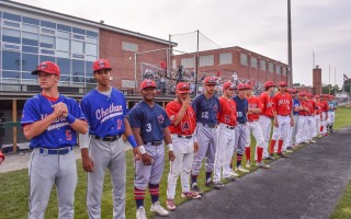 Members of the East Division All-Star team, including Chatham's Josh Shaw and Jeremy Peña, as well as Shea Langeliers, Jacob Olson and Jack DeGroat, and Harwich's Cobie Vance, Tyler Baum, and Nick Dalesandro, line up prior to the National Anthem. Kat Szmit Photo 