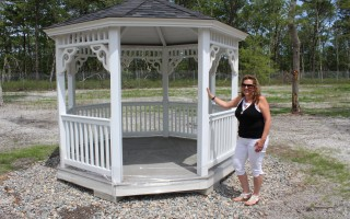 Cemetery Administrator Robbin Kelley displays the gazebo put in place at the new pet burial grounds along Queen Anne Road. FILE PHOTO  (photo: William F. Galvin)