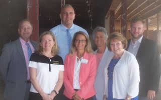 In a show of support, members of the Cape legislative delegation literally stand behind the heads of three Cape community health centers. Rear, left to right: state reps Will Crocker, Tim Whelan, and Sarah Peake and state Senator Julian Cyr. Front: Heidi Nelson, CEO of Duffy Community Health Center; Karen Gardner, CEO of Community Health Center of Cape Cod; and Pat Nadle, CEO of Outer Cape Health Services.  Ed Maroney Photo  (photo: )