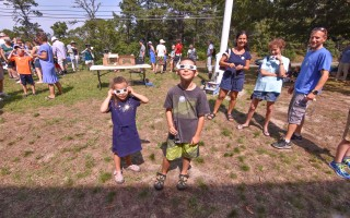Siblings Rayna and Leo Avidon check out the eclipse in action at the Marconi Maritime Center's Eclipse Party on Monday. Kat Szmit Photo  (photo: )
