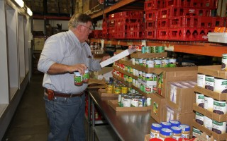 A volunteer stocks the shelves at the Family Pantry. FILE PHOTO  (photo: )