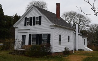 This 1860-era house at 271 Stage Harbor Rd. is one of two on the street currently under a demolition delay. After opposition from neighbors, the historical commission this week decided not to move forward with a National Historic Register District nomination for the area. FILE PHOTO  (photo: )