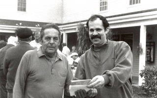 Harrison Eldredge receives gift certificates from The Chatham Winery's Glen Elison as The Cornfield's License Plate Bonanza Contest winner. 1991. FILE PHOTO  (photo: )