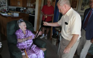 Selectmen Chairman Jon Fuller presents the Boston Post Cane to Orleans' oldest resident, Sarah Harris, on Friday. ALAN POLLOCK PHOTO  (photo: Alan Pollock)