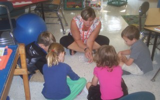 Mrs. Murray's kindergarten students gather round for a lesson.  ED MARONEY PHOTO  (photo: Ed Maroney)