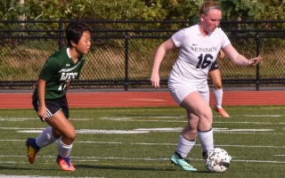 Monomoy's Maggie Dever (16) keeps the ball away from Sturgis West's Jiajun Kaczorowski (16 green) during game play Sept. 7 at Monomoy. Dever had two goals in Monomoy's 3-2 victory. Kat Szmit Photo  (photo: )