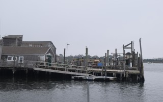 The Stage Harbor Yacht Club dock in the foreground could be included with plans to renovate the Eldredge trap dock, immediately to the east, which is owned by the town. TIM WOOD PHOTO  (photo: )