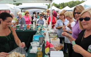 The new location of the Harwich Cranberry and Arts Festival behind the community center drew a large crowd over the weekend as was obvious at the vegetable sampling booth in the crafts fair. See page 7 for more festival photos. WILLIAM F. GALVIN PHOTO  (photo: )