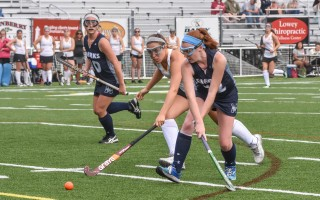 Monomoy's Caroline Howard (12) knocks the ball away from Nauset's Carmen Roderick (7).  KAT SZMIT PHOTO  (photo: Kat Szmit)