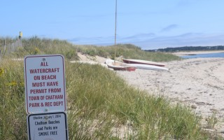 Boats like these along the shore at Forest Beach will now require town-issued stickers.  (photo: )