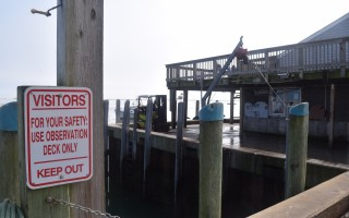 Signs are really all that keep tourists and industrial activities from mixing at the Chatham Fish Pier. Concerns are being raised about safety at the facility, which will be addressed with renovations now in the planning stages. TIM WOOD PHOTO  (photo: )
