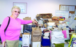 That's all for now is the message Mary Mador, immediate past president of the Friends of Snow Library, conveys as she points toward an unsorted pile of recent donations. With renovations about to begin in the Friends Room in the basement, there will be no storage space to handle additional donations. After the big autumn book sale this Saturday, Oct. 7, there will be no sales until after the first of the year. 