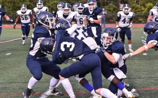 Monomoy's Noah Tambolleo (36), Connor Santoni (3), and Riley Demanche (4) work to take down Nantucket's Alex Small (22) during game play Sept. 30 at Monomoy. Kat Szmit Photo  (photo: )