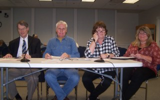 Conferring with selectmen at the traditional pre-town meeting Oct. 10 were, left to right, Town Counsel Michael Ford, Town Moderator David Lyttle, Town Clerk Cynthia May, and Assistant Town Clerk Kelly Darling. ED MARONEY PHOTO  (photo: )
