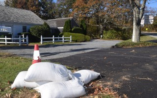 A few sandbags remain at the entrance to Dr. Neill Cowles' optometry office, which experienced severe flooding in August after a downpour apparently overwhelming the Crowell Road drainage system. Officials have commissioned an analysis of the system to determine why it failed and how it can be upgraded. TIM WOOD PHOTO  (photo: )