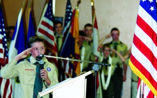 Boy Scout Christian Lapinski leads the assembly in the Pledge of Allegiance.  (photo: )