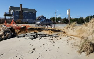 A coastal storm in late October ripped away sand placed along Cockle Cove Beach and for the first time undermined a section of the parking lot. COURTESY PHOTO  (photo: )