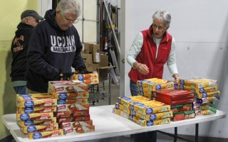 Jay Herzog and Christine Menard set up the pie station for Sunday's special food distribution. DEBRA DeCOSTA PHOTO  (photo: Debra DeCosta)