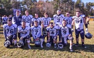 Monomoy football's seniors - Nathan Amaker, Clay Howell, Zach Souza, Gavin Viera, Connor Santoni, Tim McCabe, Cam Jones, Ben Hall, Jake Wisniewski, Griffen Handler, Riley Demanche, and Eli Nickerson - celebrate their team's big 32-7 victory against Sacred Heart on Thanksgiving Day. Kat Szmit Photo  (photo: Kat Szmit)