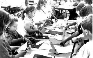 A group  of second graders from Chatham put scissors and glue to paper during a visit from children's illustrator Giles Laroch. 1994. FILE PHOTO  (photo: )
