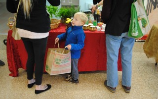 Four-year-old Caleb Jones of Orleans holds the grocery bag while mom makes a selection.  BARRY DONAHUE PHOTO  (photo: Barry Donahue)