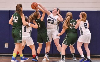 Monomoy's Maddie Leonard (23) blocks a shot from Sturgis West opponent Lily Manning (11) during game play Dec. 11 at Monomoy. Kat Szmit Photo  (photo: )