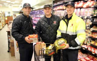 Chatham firefighters (from left) Seth Karter, Scott Long and James Young scope out the goods at Chatham Village Market. ALAN POLLOCK PHOTO  (photo: Alan Pollock)
