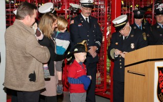 Fire Chief Peter Connick (right) prepares to give an honorary chief's badge to young Jesse Nash.  PHOTO COURTESY MARK HELLER  (photo: Mark Heller)