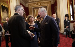 Michael and Margaret Tompsett chat with Prince Charles after the ceremony. COURTESY PHOTO 