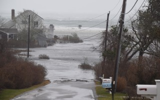 Climate change will lead to more frequent flooding of low-lying coastal neighborhoods like Old Wharf Road in North Chatham.  FILE PHOTO  (photo: Tim Wood)