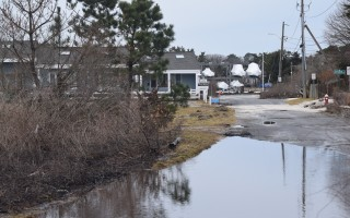 Water remains in Little Beach roads flooded during storms in January and February. Property owners in the low-lying area are working with town officials to develop strategies to combat future flooding. TIM WOOD PHOTO  (photo: )
