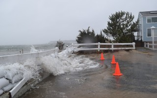 Stormwater breaks through sand bags at Little Beach. TIM WOOD PHOTO  (photo: )