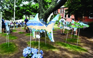 Sharks on the lawn of the Eldredge Public Library last summer. The Sharks in the Park exhibit will be back in June, and will spend the entire summer on the front lawn of the library. 