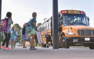 Students arrive at Harwich Elementary School on the first day of classes in September. Educators and administrators in the Monomoy district are making sure safety protocols are strong in the wake of gun violence in Florida. FILE PHOTO  (photo: )