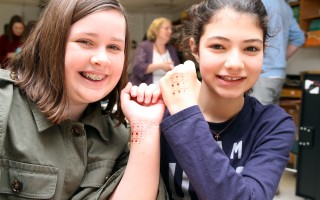The sixth graders, including Suzie Sheeran (left) and Victoria Letendre, each received a sheet of temporary tattoos with life-sized representations of ticks. ALAN POLLOCK PHOTO  (photo: Alan Pollock)