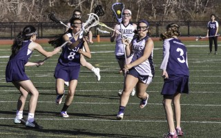 Monomoy's Kelsey Olson (1) keeps her eye on the opening between opponents as she maneuvers the ball into scoring territory for the Sharks against CCA.  KAT SZMIT PHOTO  (photo: Kat Szmit)