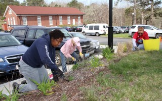 An Americorps Cape Cod worker and two Chatham Marconi Maritime Center volunteers were among around 50 people who took part in CARE's Marconi Center spruce-up.  ALAN POLLOCK PHOTO  (photo: Alan Pollock)