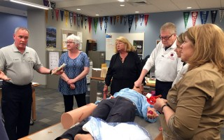 Harwich EMS Officer Rob Sanders (left) explains the proper technique for staunching a major hemorrhage during last week's Stop the Bleed training at Monomoy High School.  HFD PHOTO  (photo: Courtesy Harwich Fire Department)