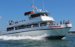The Freedom Ferry steams out of Saquatucket Harbor on its way to Nantucket.  FILE PHOTO  (photo: William F. Galvin)