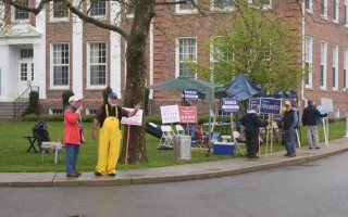 Candidates wave to passersby outside of the community center Thursday. TIM WOOD PHOTO  (photo: )