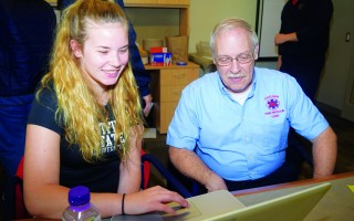 Chatham Fire Chief Peter Connick views a PowerPoint presentation senior Haley Kelley made about her internship at the department. TIM WOOD PHOTO  (photo: Tim Wood)