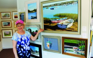 Guild of Harwich Artists President Chris Banks displays some of the art that is located in the Guild's gallery along Route 28 in Harwich Port. WILLIAM F. GALVIN PHOTO  (photo: William F. Galvin)