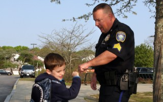 Sgt. Bill Massey gets an enthusiastic morning fist-bump from kindergartner Kellan Whitney. ALAN POLLOCK PHOTO  (photo: Alan Pollock)