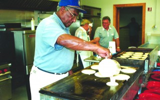 A member of the Kiwanis Club of Central Cape Cod Pours out pancake batter during a past Pancake Festival. The event returns again July 4 after a three-year absence. FILE PHOTO  (photo: )