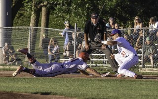 Chatham first baseman Michael Busch (33) isn't quite in time with the tag on Harwich's Matt Gorski (34) as Gorski dives back to base avoiding a pickoff. Kat Szmit Photo  (photo: )