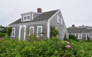 "The antique house at 154 Champlain Rd., known as ""Starboard Light,"" is for sale. The house was featured in a 2013 documentary about a family's decision to sell their summer home.  (photo: )"
