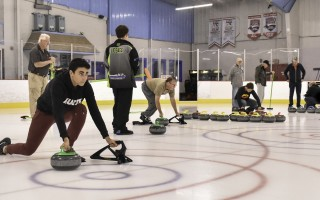French exchange student Sacha Mariani (far left) tries his hand at throwing a curl during a Learn to Curl session Monday night at the Charles Moore Arena in Orleans. The classes are being held in the hopes of starting a local curling club. Kat Szmit Photo  (photo: )